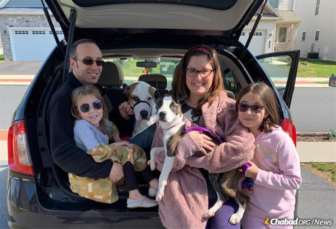 Because of the coronavirus pandemic, Brian and Mara Egorin-Williams, and daughters Natasha, 6, and Norah, 10, will celebrate Hanukkah at home this year, though they will join the local car-menorah parade, which Brian is helping coordinate.
