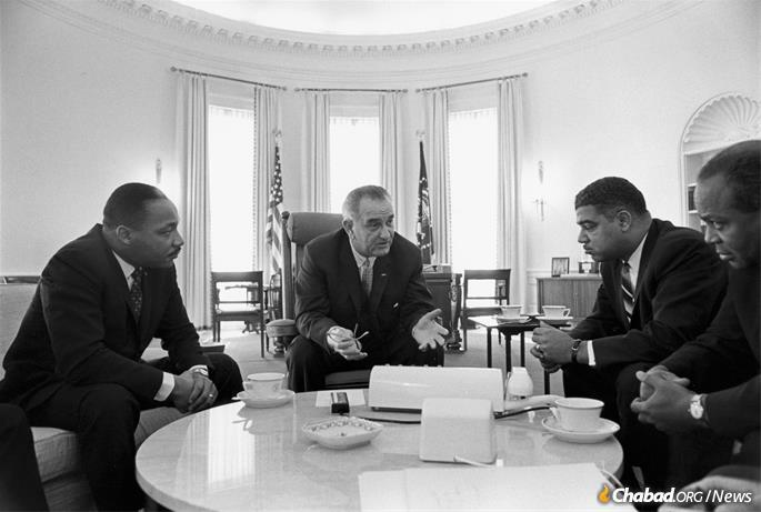 Civil-rights leaders Martin Luther King Jr. (left), Whitney Young and James Farmer (right) meet with President Lyndon B. Johnson at the White House in 1964. (Credit: Yoichi Okamoto via the Lyndon Baines Johnson Library and Museum)