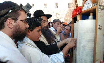 Nadav Elharar is called, for the first time in his life, to recite the blessings over the Torah scroll