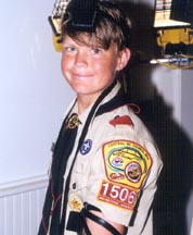 A Jewish Boy Scout proudly wearing tefillin