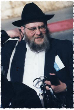 "Rabbi Samuels with his Tefillin in hand as he looks for some more ""customers"" to put on Tefillin"