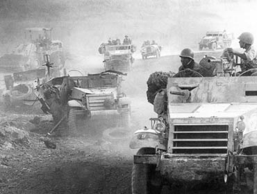 IDF forces ascend the Golan Heights as abandoned Syrian tanks lay near the road. Photo: Israel National Photo Archive