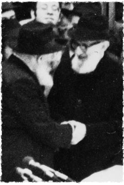 Rabbi Joseph B. Soloveitchik is greeted by the Rebbe at a gathering in Lubavitch World Headquarters.