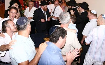 Members of the Jewish community of Vietnam dance in welcoming the new new Torah written for the Jewish community in Vietnam. Sixty members of the Jewish community greeted the Torah written for the Chabad-Lubavitch synagogue in Ho Chi Minh, the first synagogue established in the county.