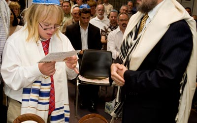 Wesley Baer, 13, recites the blessings at the Torah at his bar mitzvah at Chabad-Lubavitch of Palos Verdes. Wesley was born with Down syndrome and just completed a year of studying Hebrew, Jewish history, Jewish holidays and the religion's traditions with Rabbi Yitzi Magalnic.