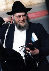 """Rabbi Samuels with his Tefillin in hand as he looks for some more """"customers"""" to put on Tefillin"""