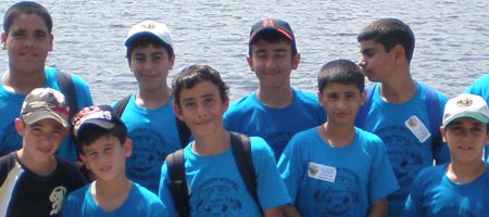 A group of Israeli children from Sderot pause for a picture by the lake of their suburban Boston summer camp.