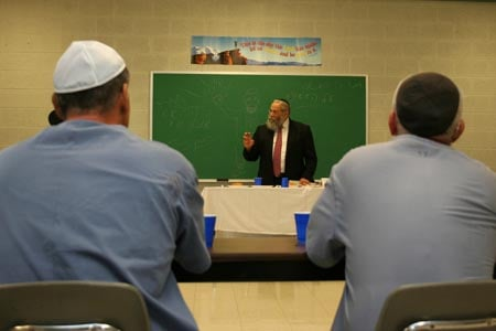 Under the auspices of the Aleph Institute – a prison rehabilitation organization founded in 1981 – 10 Chabad-Lubavitch rabbinical students visited inmates at Dade Correctional Institution in Florida City, Fla. The program, called ''Yeshivah Behind Bars,'' gave students three nine-hour days to learn Jewish texts, pray and eat meals with 13 inmates. In this photo, Rabbi Sholom Ber Lipskar, director of the Aleph Institute and co-director of Chabad-Lubavitch of Bal Harbor, gives a lecture to inmates.