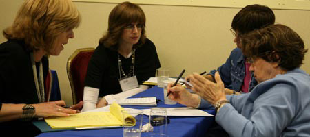 Comparing notes in between sessions at the Chabad-Lubavitch educational conference. Photo: Benjamin Lifshitz