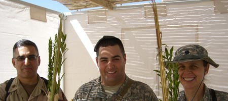 Maj. Mark Wynne, left, joins Maj. Craig Wertheim and Lt. Col. Donna Lullen in a Sukkah provided by the Aleph Institute at their station in Iraq.