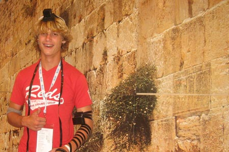 While this year's JCC Maccabi Games in Houston brought together Jewish athletes from all over the country, the Chabad-Lubavitch booth at the event took them to Israel by letting the boys put of tefillin in front of a backdrop of the Kotel.