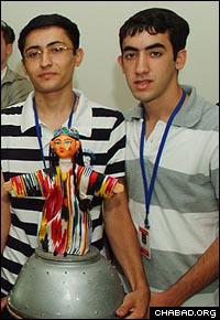 Itzik Yalizerov and Alex Chaimov show off one of their dancing Bukharan robots.