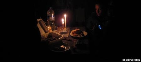 Candle light meal. Chabad-Lubavitch rabbinical students bring food to stranded Israelis in Ica, Peru