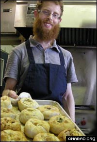 Yudi Weinbaum shows off a fresh batch of knishes. The ethnically Jewish foodstuff was until recently missing from most Hawaiians' palates.
