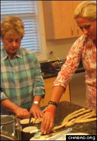 Learning the art of challah-baking at a women's circle event in the Hamptons.