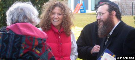 Rabbi Leibel Baumgarten greets community members in the Hamptons.