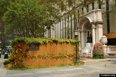 Chabad-Lubavitch of Midtown's sukkah in Bryant Park occupied a prime piece of real estate next to the William Cullen Bryant Memorial and right behind the main branch of the New York Public Library. (Photos: Yosef Lewis)