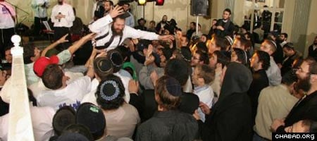 Rabbi Dov Yona Korn, co-director of the Chabad House serving New York University, stage dives during a concert at last year's International Student Shabbaton & Conference.