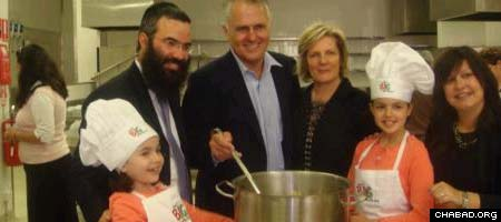 MP Malcolm Turnbull at the new kitchen with young volunteers