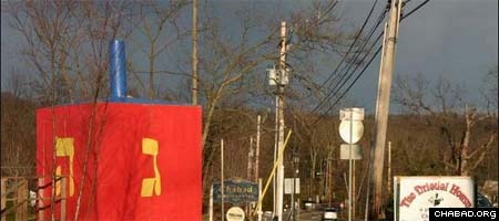 Chabad-Lubavitch of Greater Somerset County's 18-foot dreidel greets passing motorists and pedestrians.