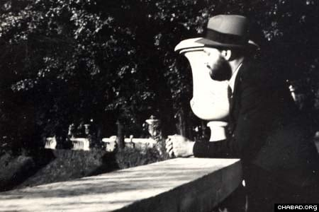 The Rebbe, Rabbi Menachem Mendel Schneerson, of righteous memory, looks out over a bridge at the Jardin du Luxembourg park in Paris in this picture from the 1930s. The Agudas Chasidei Chabad library, headed by Rabbi Sholom Ber Levine, released the picture for use by Jewish Educational Media. (Photo: Jewish Educational Media)