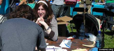 Bracha Sara Leeds sits down with a student at the University of California at Berkeley.
