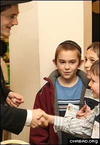 Students get a chance to greet their teacher.