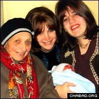 Four generations: Leah Raichik, Devora Wilhelm and Simi Mishulovin at the 2004 circumcision of Shmuel Dovid Mishulovin, named after Raichik's husband, the late Rabbi Shmuel Dovid Raichik