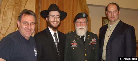 Lenny Chornock, left, deputy fire chief of the Rockville Volunteer Fire Department; Rabbi Chesky Tenenbaum; Rabbi Jacob Goldstein; and Eric Bernard, president of the RVFD