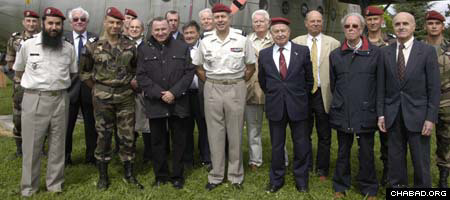 Rabbi Gavriel Sebag, left, stands with some members of the French military.