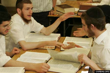 Students in the yeshiva portion of the Detroit school debate issues in Jewish law. They also study Talmud and Chasidic philosophy, but dedicate their free time to helping others in the wider community.