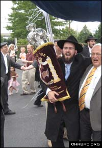 The Jewish community of Annapolis celebrates a new Torah written for the Chabad-Lubavitch center there.