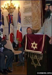 French Army chaplain Rabbi Gavriel Sebag speaks from the podium.