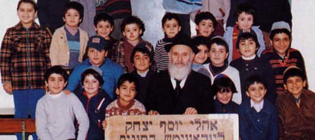 Rabbi Nisson Pinson with students at the Lubavitch day school in Tunis