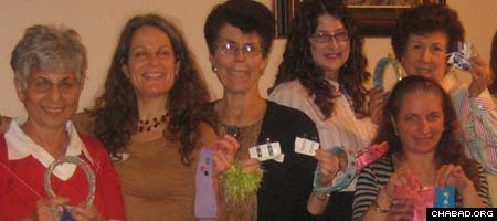 Members of Chabad-Lubavitch of Orange County's Jewish Women's Circle hold up hair accessories destined for pediatric hospital patients.