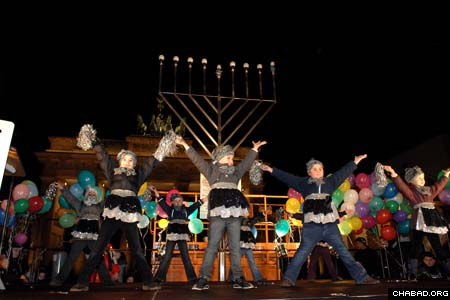 Children from the school operated by Chabad-Lubavitch of Berlin begin Tuesday night's menorah lighting ceremony with a dance performance. (Photos: Meir Dahan)