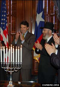 Texas Gov. Rick Perry, left, welcomed a delegation of 16 Chabad-Lubavitch rabbis to his capitol office for a Chanukah reception.