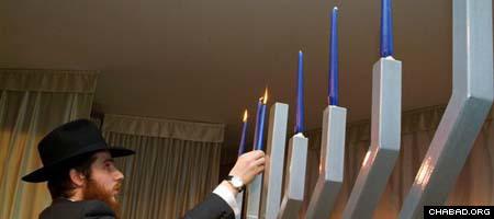 Rabbi Yisroel Silberstein lights Vladivostok's Chanukah menorah.
