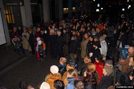 Hundreds gather at a central square in Baden, Germany's capital city for Chabad-Lubavitch of Karlsruhe's Chanukah menorah lighting. Member's of Baden's government and justices of Germany's Federal Constitutional Court were in attendance for the Dec. 9 ceremony.