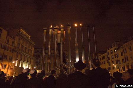 A slew of dignitaries joined Rome's Jewish community in celebration of 20 years of public menorah lightings in the Italian capital. The list included Rome's security chief Jean Leonard Touadi, regional president Piero Marrazzo, Sen. Piero Fassino, House of Deputies member Andrea Ronchi, Canadian Ambassador Alexander Himmelfarb and Israeli Ambassador Oded Ben Hur. Jonathan Cohen represented the United States Embassy. Chief Rabbi Riccardo Shmuel Di Segni recited the blessings on the menorah, while Roberto Haggiag kindled the lights. (Photo: Francesca Padovan)