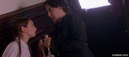 "Played by Judy Winegard, right, Miss Agatha Grimshaw takes away the Shabbat candles belonging to Miriam Aronowitch, played by Abby Shapiro in the new movie ""A Light for Greytowers."""