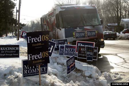 Campaign posters crowd a downtown street in Manchester, N.H., before the state's first-in-the-nation primary elections Jan. 8. For the occasion, Chabad-Lubavitch of New Hampshire, opened a temporary Chabad House to cater to the Jewish campaign workers, poll officials, media representatives and voters who arrived to the state's largest city.