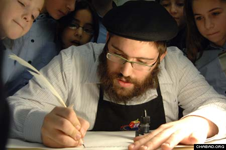 """Children gather around scribe Rabbi Benny Hershkowitz as he carefully pens a letter during the hands-on demonstration """"Torah Unwrapped"""" at the Jewish Children's Museum in Brooklyn, N.Y. The public exhibit takes place every Sunday until March 2 at the Chabad-Lubavitch institution. (Photos: Todd Maisel/The Daily News)"""