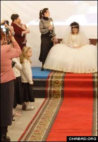 Bride Bela Stradovtv says Psalms during a bridal reception prior to Tomsk, Russia's first Jewish wedding in a century.