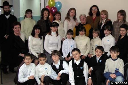 The new residents of the Planet of Childhood home for children of impoverished families in Krivoy Rog, Ukraine, pose for a picture with the staff of the city's Or Avner Chabad Day School, which administers the facility. The 12 children will take classes at the school, which celebrated the new wing's grand opening last week. Community member Mikhail Marmer made the project possible.