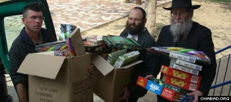 Volunteers with Chabad-Lubavitch of Ashkelon, Israel, deliver toys and board games to the city's schools after officials banned recess in the wake of Palestinian rocket attacks.