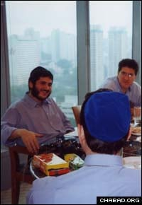 Chabad-Lubavitch rabbinical student Mendy Kotlarsky gives a Torah class to Jewish businessmen in Singapore.