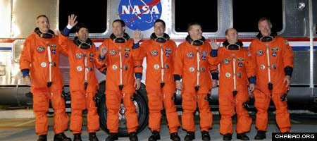 The crew of the space shuttle Endeavor, which lifted off early Tuesday morning. Garret Reisman, second from right, became the first Jewish resident of the International Space Station on Thursday.
