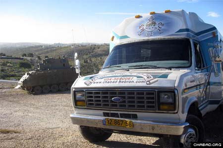 """A Chabad-Lubavitch """"synagogue on wheels"""" from the Israeli city of Hebron arrives at an IDF outpost to bring some Purim happiness to Israel's frontline soldiers."""