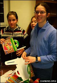 Students from the University of Illinois at Urbana-Champaign make Purim gift baskets known as mishloach manot.